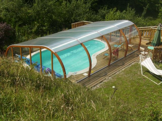 abri piscine sur terrasse bois abris par apc. Black Bedroom Furniture Sets. Home Design Ideas